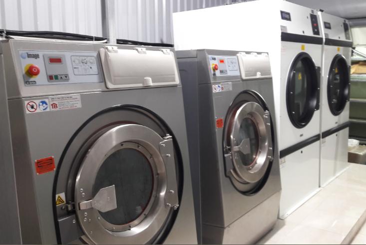 Điện năng tiêu thụ cho máy giặt sấy công nghiệp tính như thế nào ?